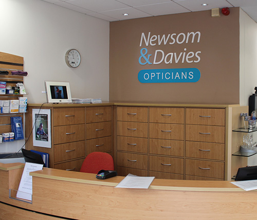 Newsom & Davies shop reception with new internal signage