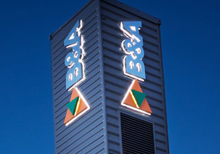 B&A Group illuminated tower signage at night