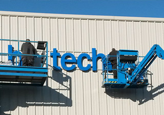 Biotechne sign installation with cherry pickers