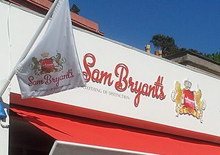 Shop frontage with flags and branded awning